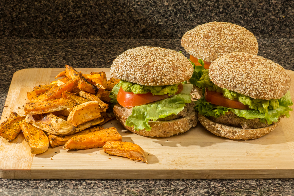 Vegan bean/quinoa guacamole burger with yam fries