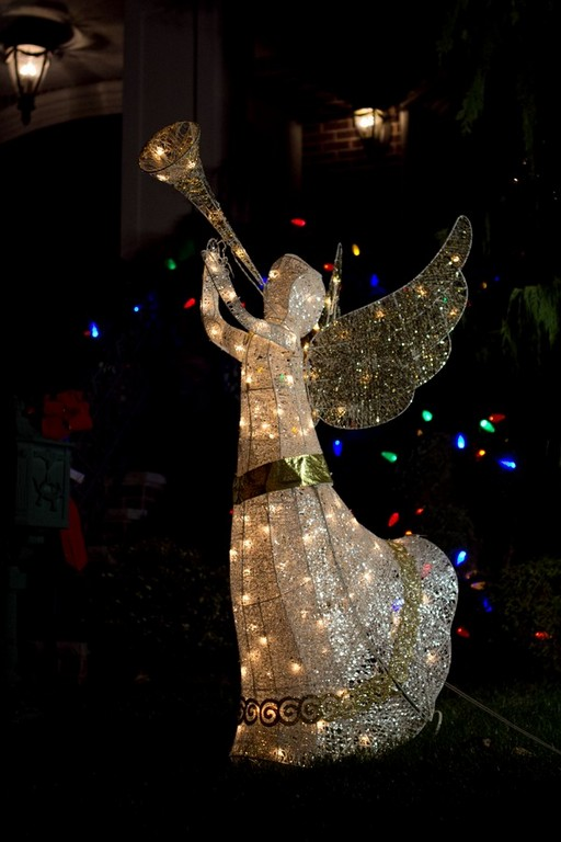 angel blowing on instrument on christmasjpg