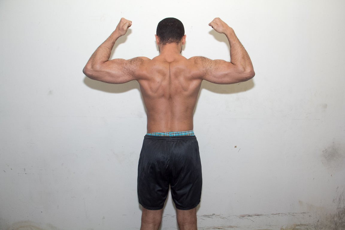 back flexed after three months of bodybuilding